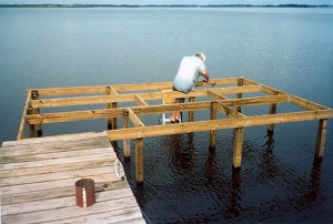 dad builds his dock again after the hurricane